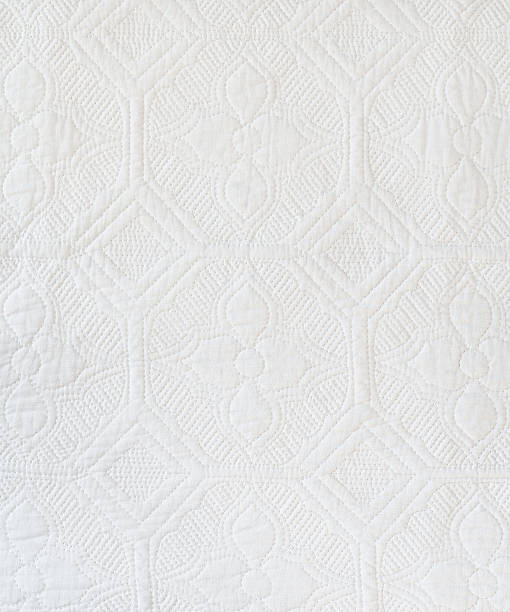 white quilt background/texture - quilt stock photos and pictures