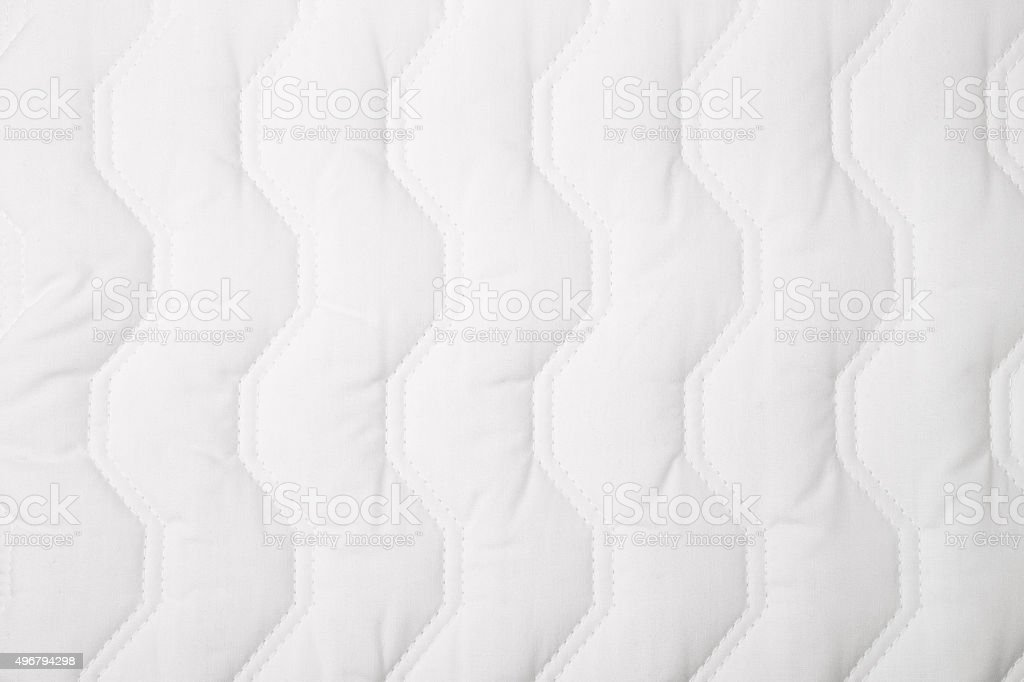 White quilt pattern stock photo