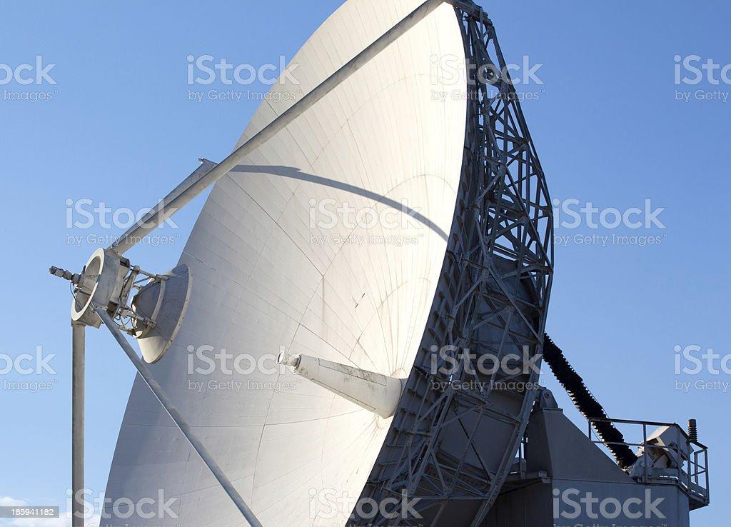 White radio telescope against a blue sky royalty-free stock photo