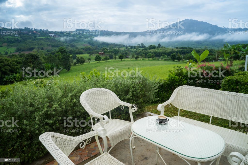 Swell White Rattan Sofa Chair And Table On The Terrace In The Squirreltailoven Fun Painted Chair Ideas Images Squirreltailovenorg