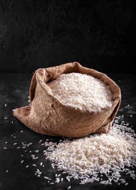 White raw basmati rice in burlap bag. space, text White raw basmati rice in burlap bag. space, text. basmati rice stock pictures, royalty-free photos & images