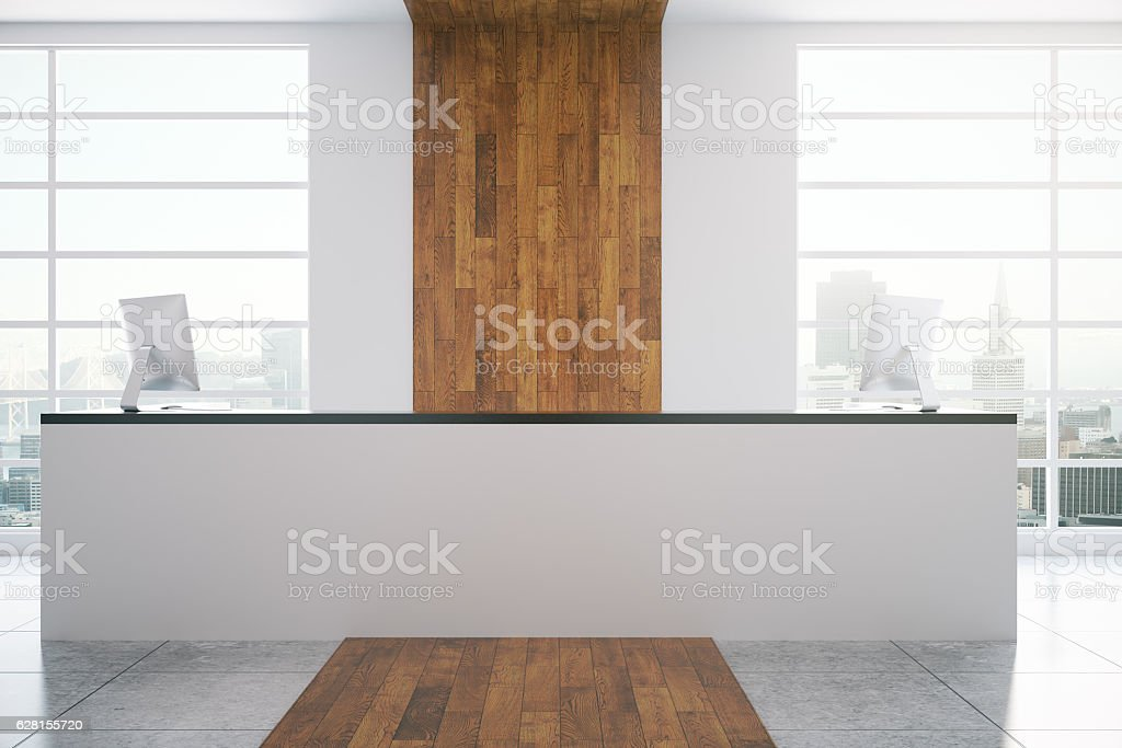 White reception desk in wooden interior stock photo