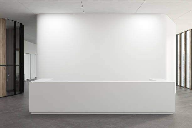 white reception in a white office lobby - receptionist stock photos and pictures