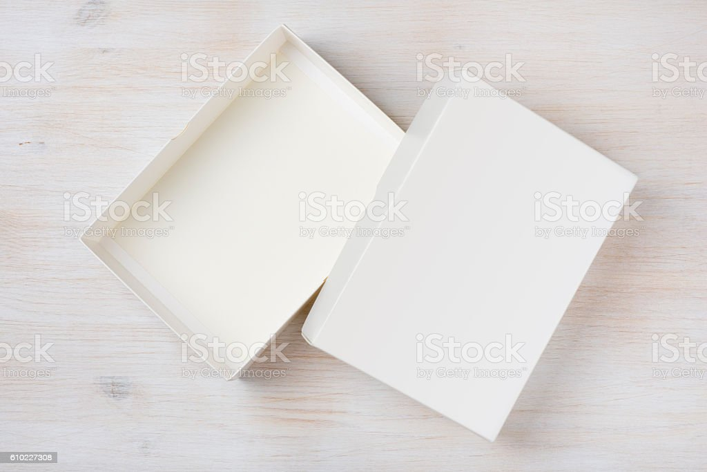 White rectangular empty open box, top view on wooden background stock photo
