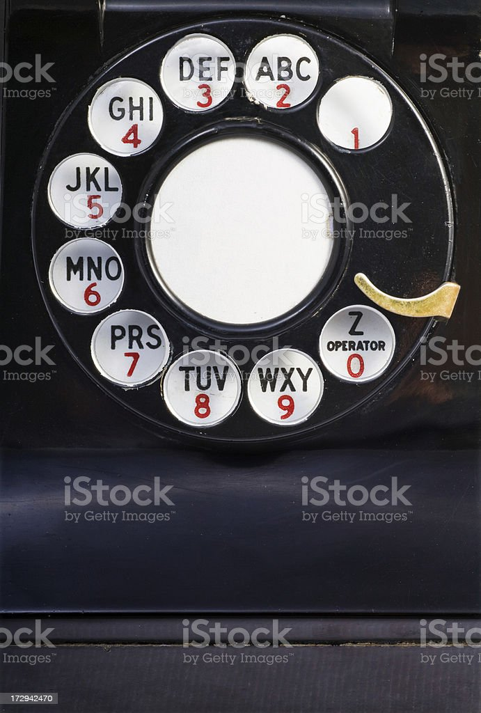 White, red and black buttons on a vintage phone dial.  stock photo