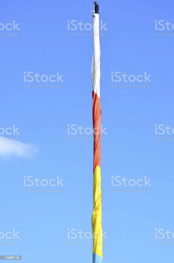 White red and yellow rolled up flag royalty-free stock photo