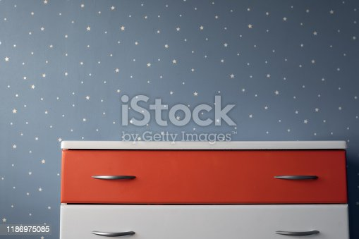 1151171813 istock photo white red night table and dark blue starry wall in bedroom 1186975085
