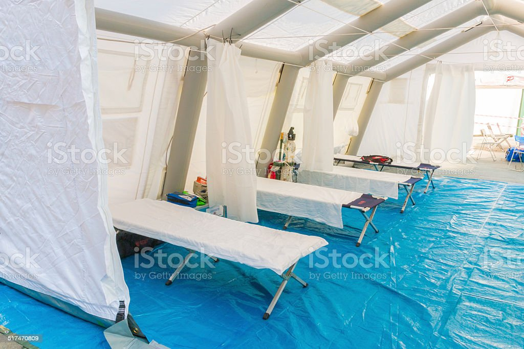 white rescue control centre tent with camp bed stock photo
