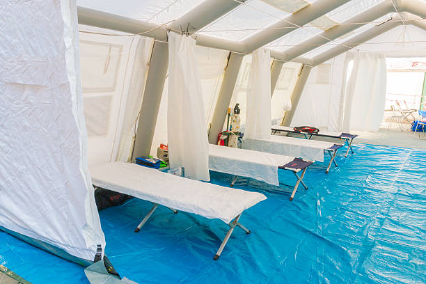white rescue control centre tent with camp bed white rescue control centre tent with camp bed and Emergency equipment tent stock pictures, royalty-free photos & images