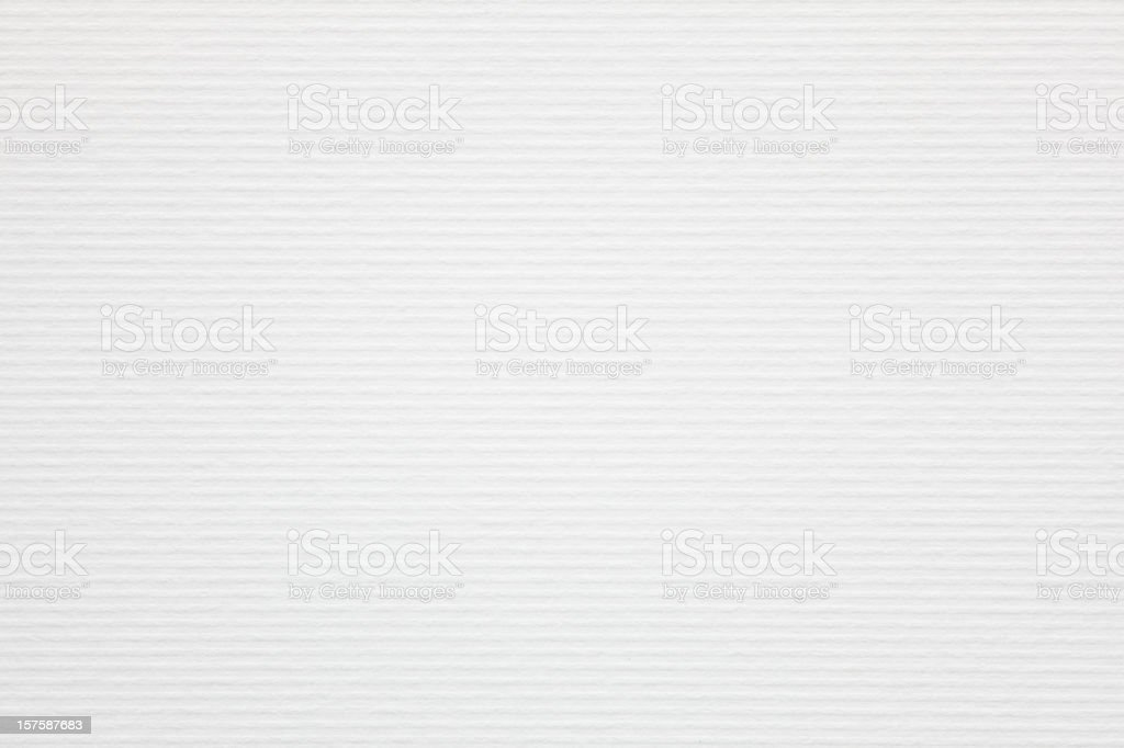 white ribbed paper as background stock photo