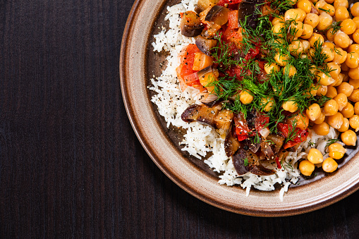 White rice and vegetables on wooden table