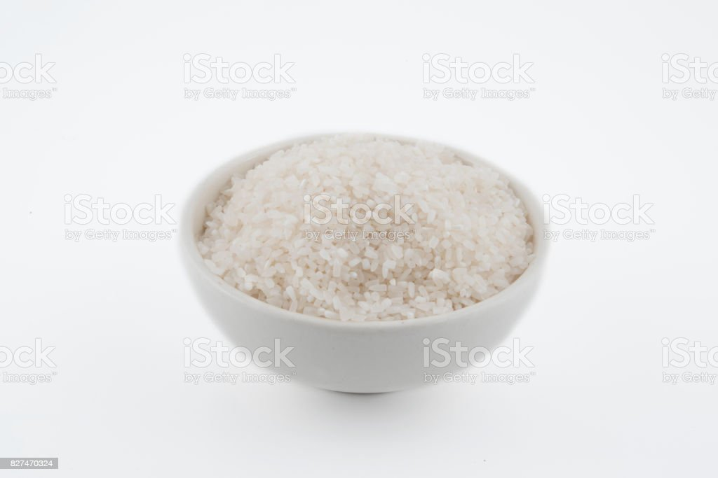 white rice, natural long rice grain for background and texture on white background stock photo