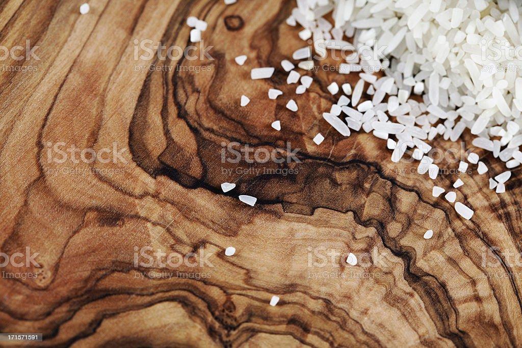 White Rice on Olive Wood Background royalty-free stock photo
