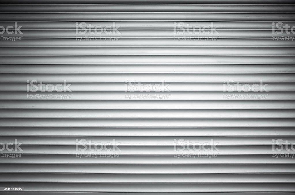 White ridged metal wall background texture stock photo