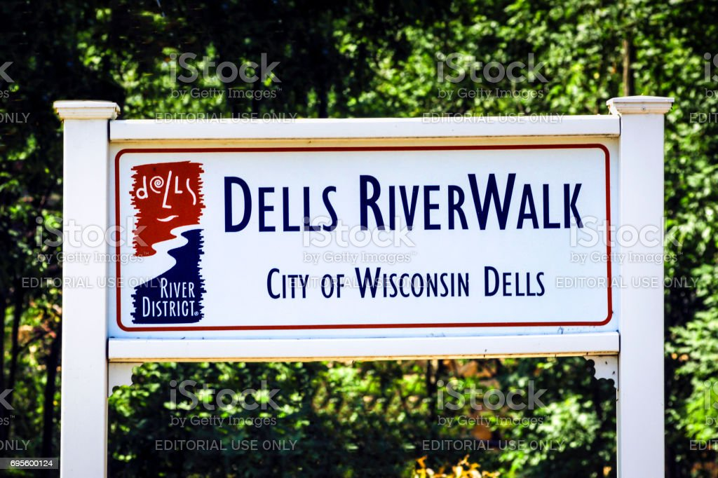 A white Riverwalk sign in the city of Dells in Wisconsin, USA stock photo