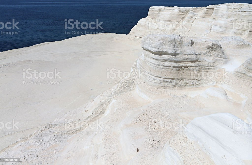 White rock formations at Mylos island, Greece stock photo