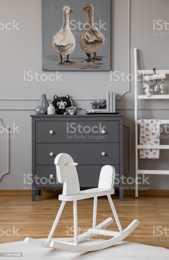 Fabulous White Rocking Horse On Rug In Grey Kids Room Interior With Spiritservingveterans Wood Chair Design Ideas Spiritservingveteransorg