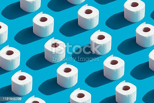 White roll toilet paper on the  blue background