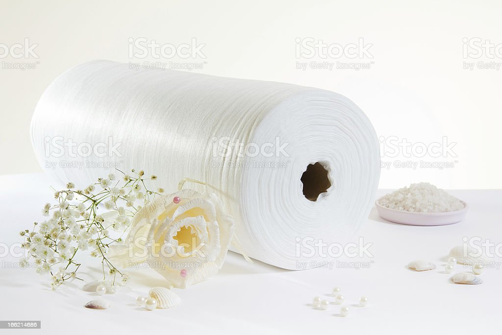 white rolled towel and salt stock photo
