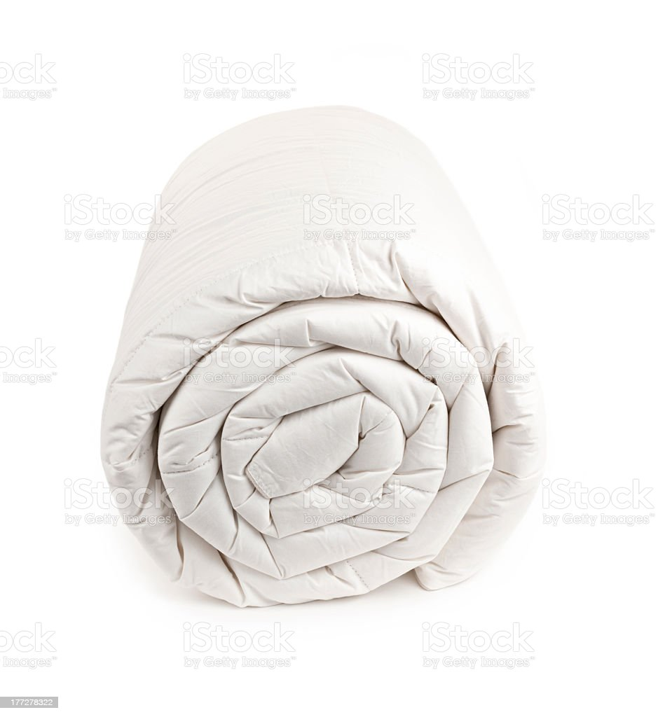 A white rolled up duvet on white stock photo