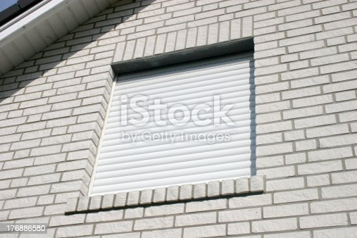 istock White roller blind at a brick house 176886580