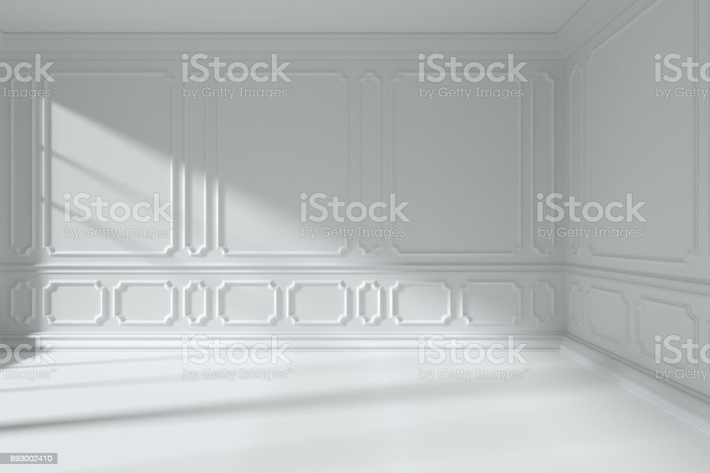 White room with classic style molding frames on walls stock photo