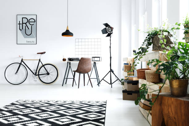 white room with green plants - arbeitszimmer möbel stock-fotos und bilder
