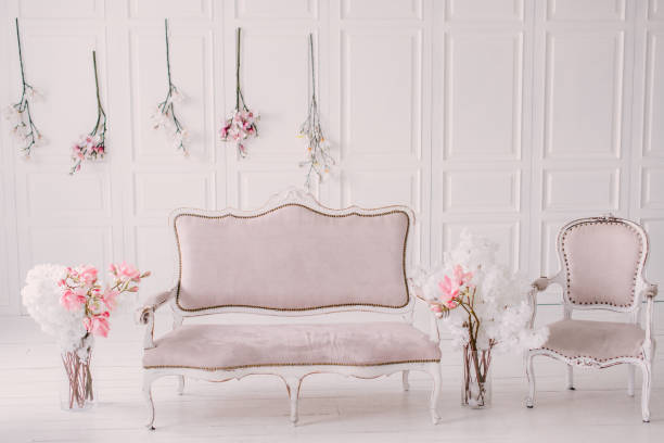 White room with vintage interior and spring flowers stock photo