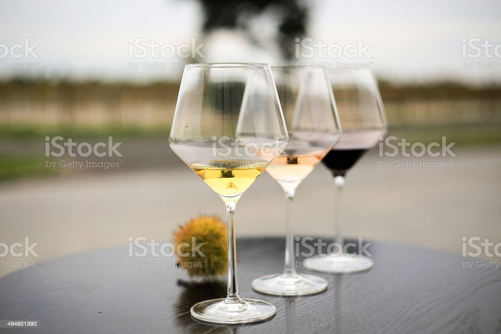 White, rosé and red wine - horizontal stock photo