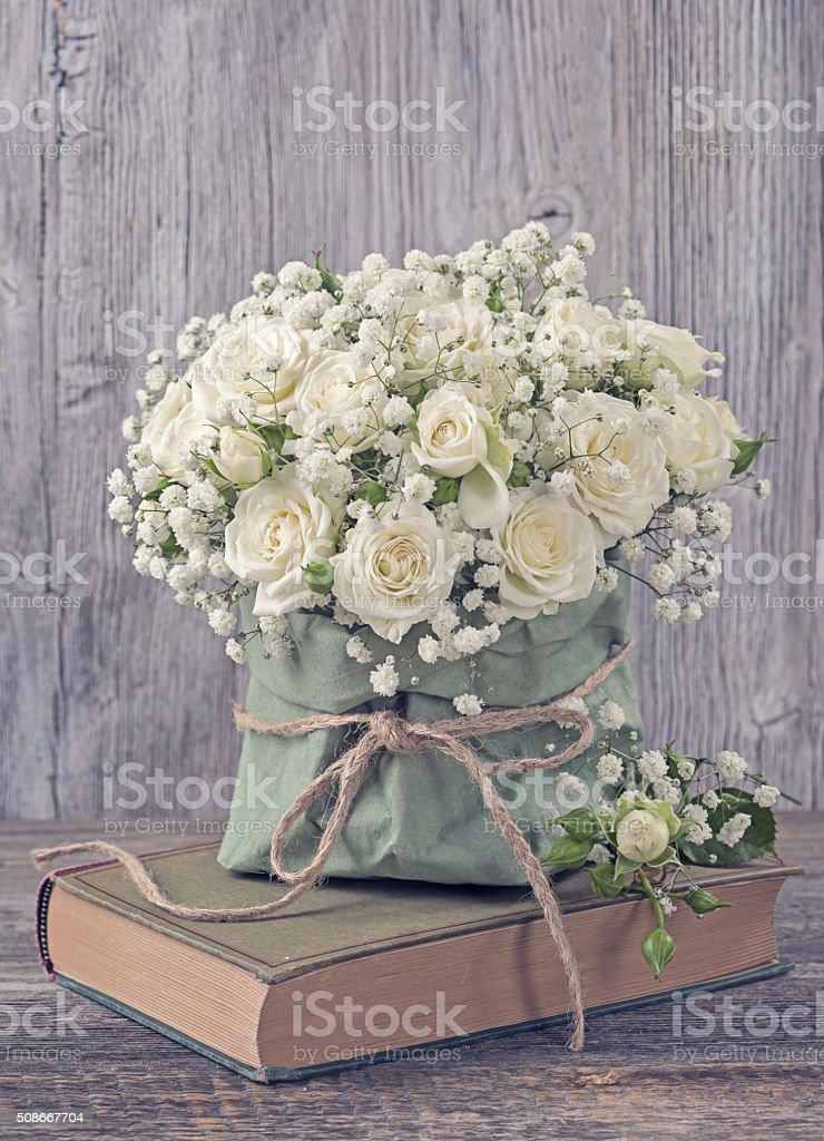 White roses and a book stock photo