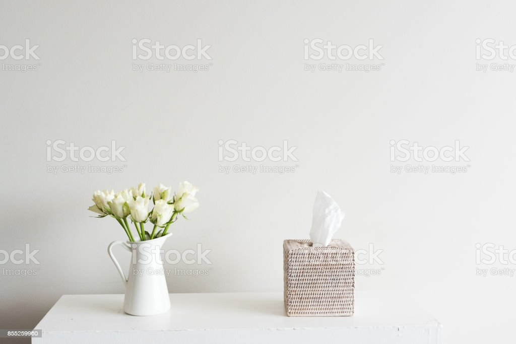 White roses and tissue box stock photo