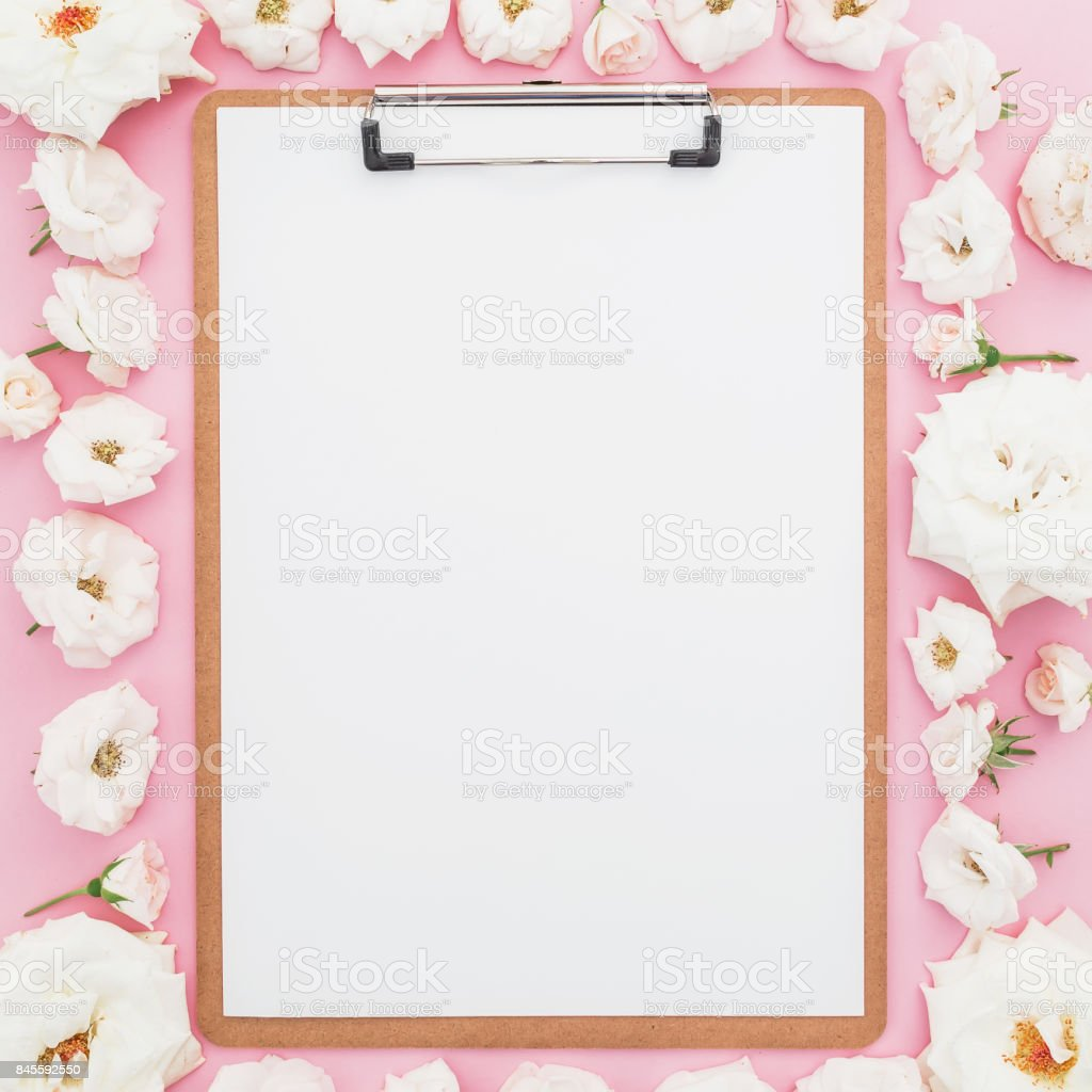 White Roses Flowers With Clipboard On Pink Background Flat Lay Top ...