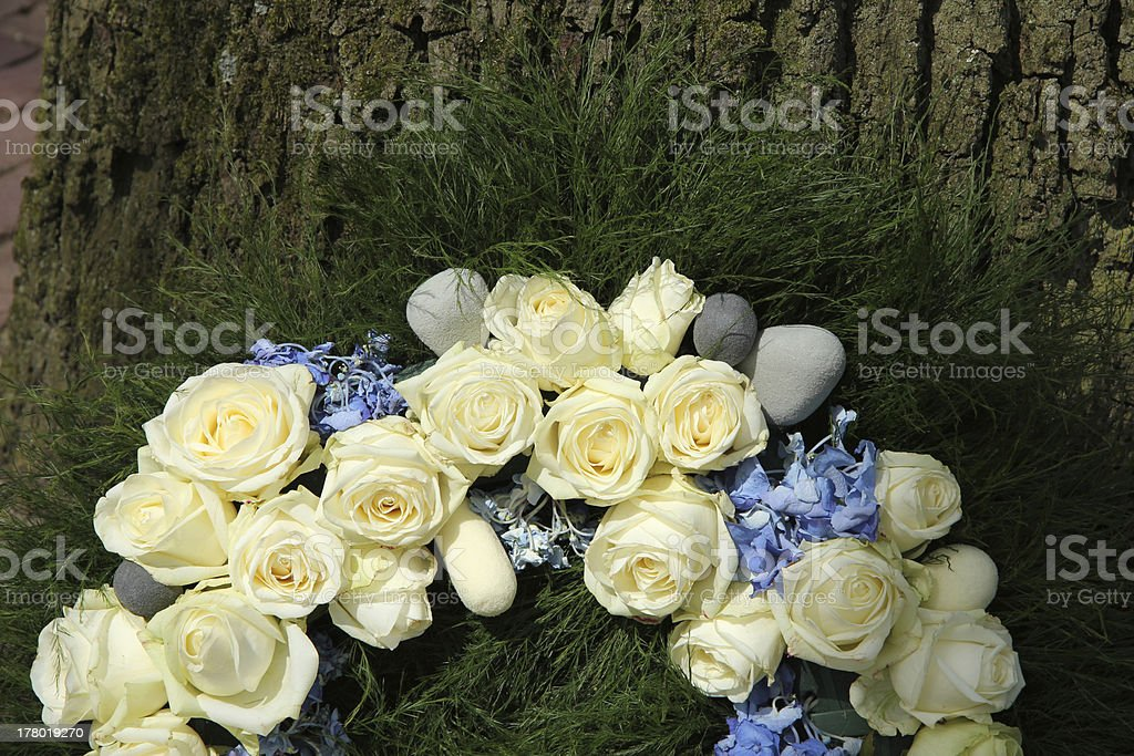 White roses on a sympathy wreath stock photo