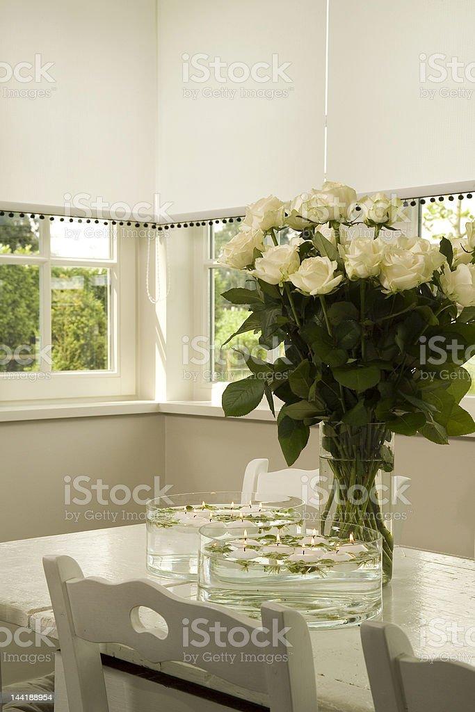 White Roses on KitchenTable royalty-free stock photo