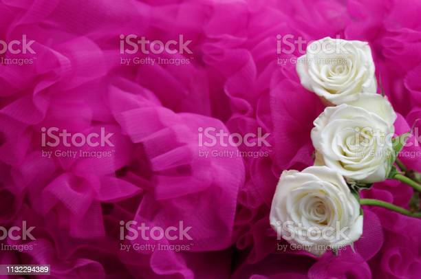 White roses on pink ruffles with copy space picture id1132294389?b=1&k=6&m=1132294389&s=612x612&h=pjgvr2ywjzawjcd7ts7bm zg7f9fiwsuvlhisd 2wlo=