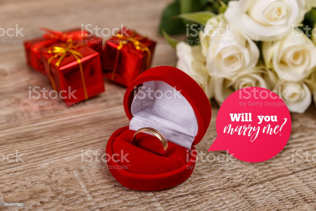 White roses with engagement ring. Will you marry me design....