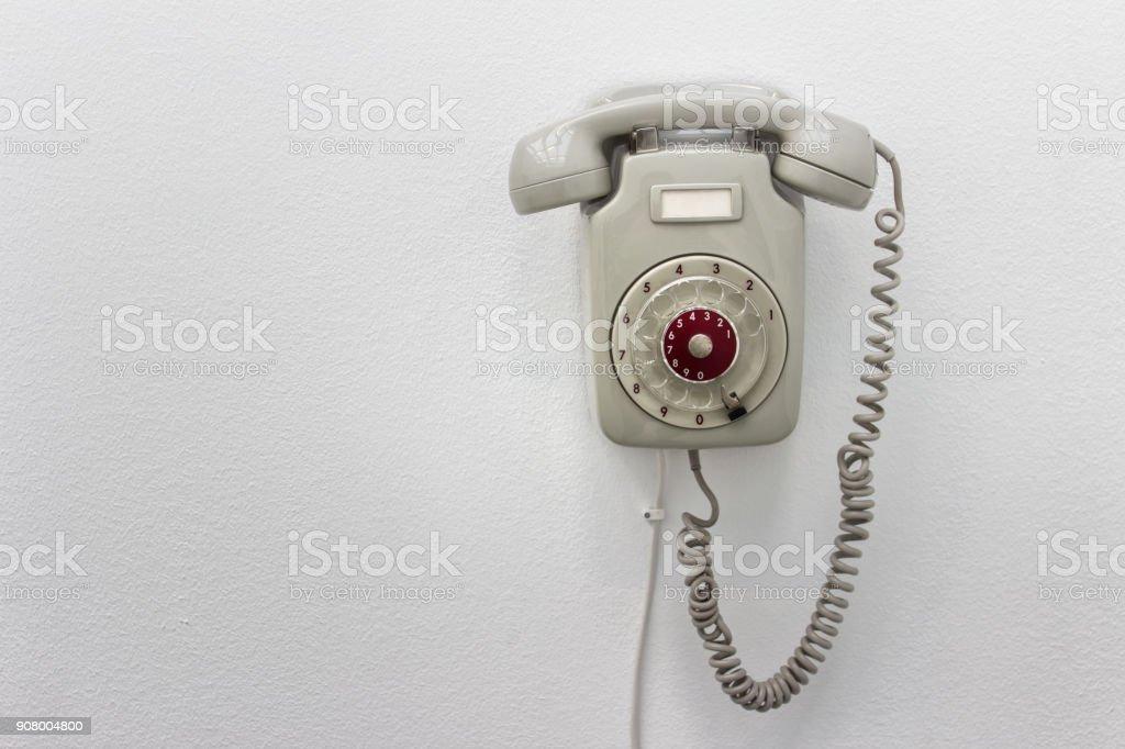 White rotary telephone stock photo
