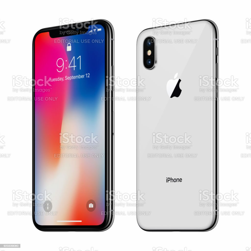 White rotated Apple iPhone X with iOS 11 lockscreen front side and back side isolated on white background stock photo