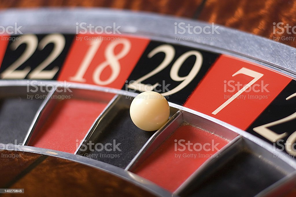 A white roulette ball landing on number 29 stock photo