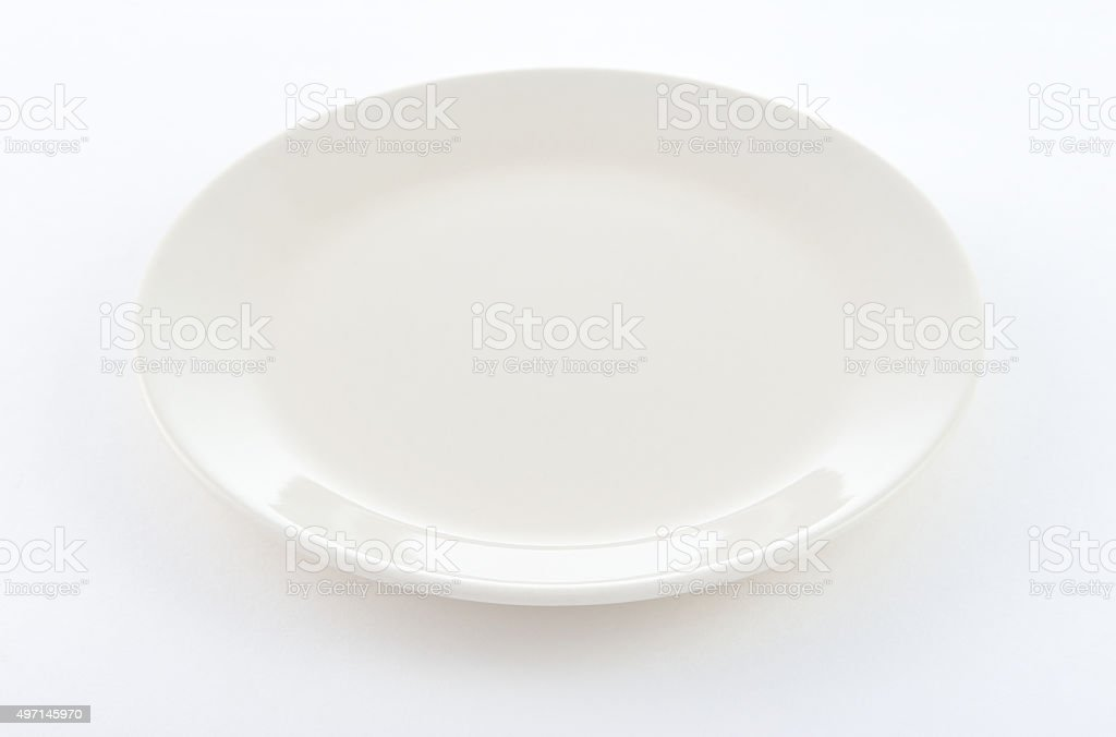 white round plate on white background stock photo