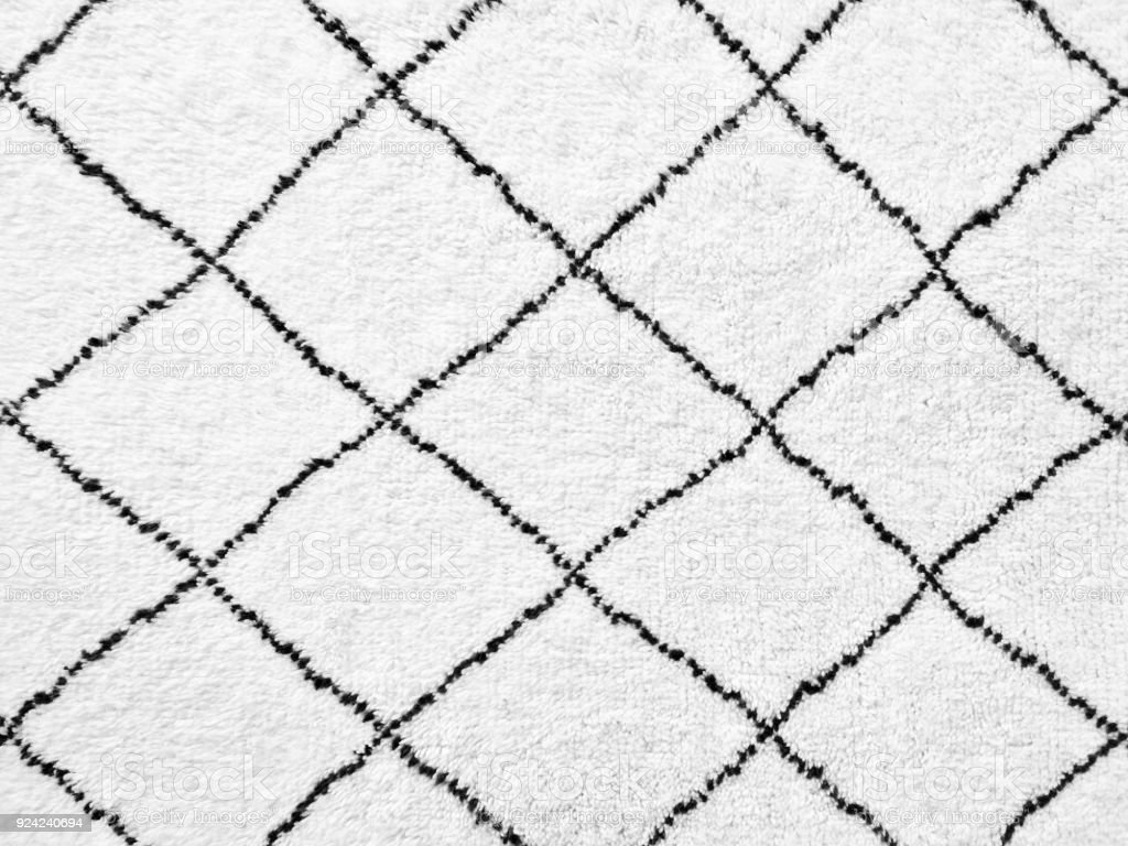 White rug with simple black lines design White rug with black lines. Simple geometric design. Backgrounds Stock Photo