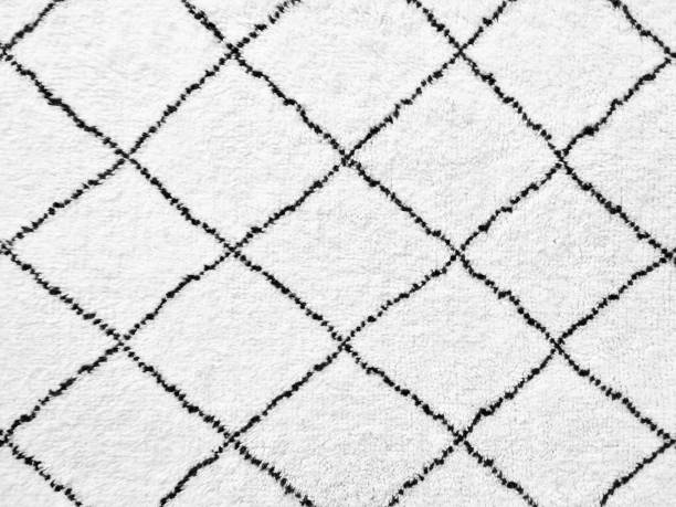 White rug with simple black lines design stock photo