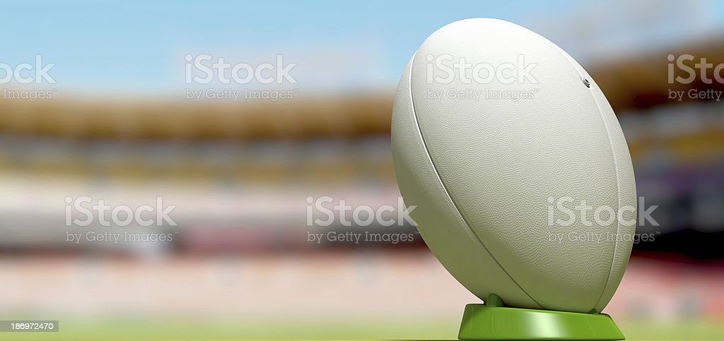 White rugby ball in the background of stadium stock photo