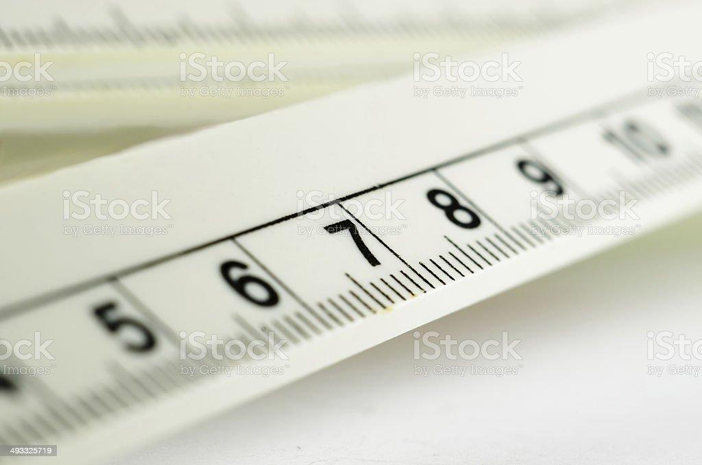 White ruler macro number seven stock photo