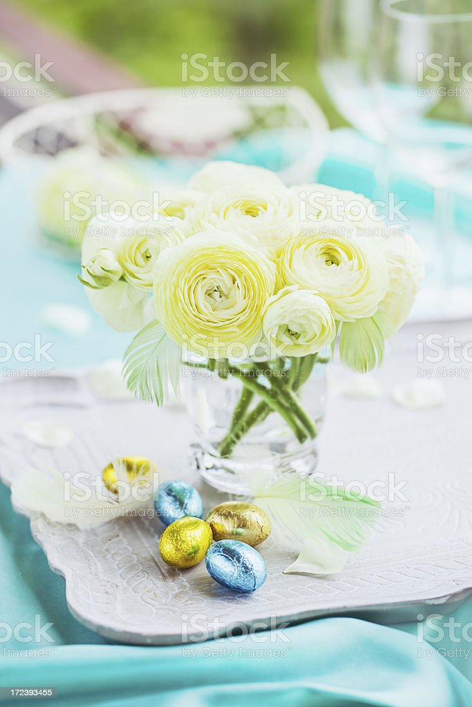 White rununculus bouquet and easter eggs royalty-free stock photo