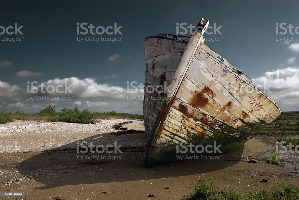 White rusty prow on the beach royalty-free stock photo