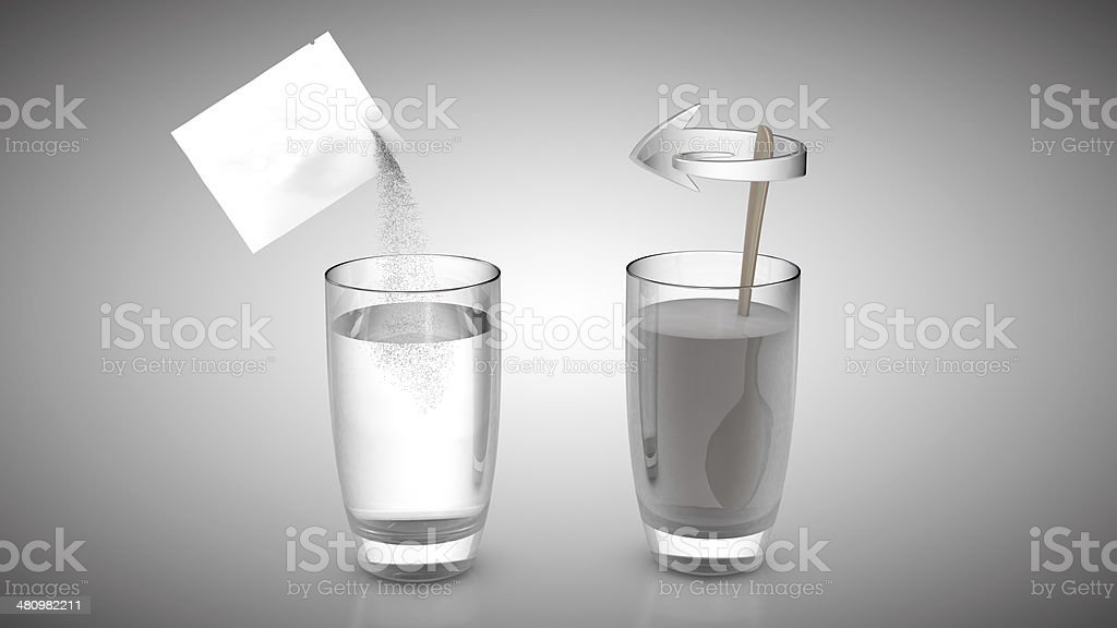 White Sachet with crystalline powder stirred into water glas stock photo