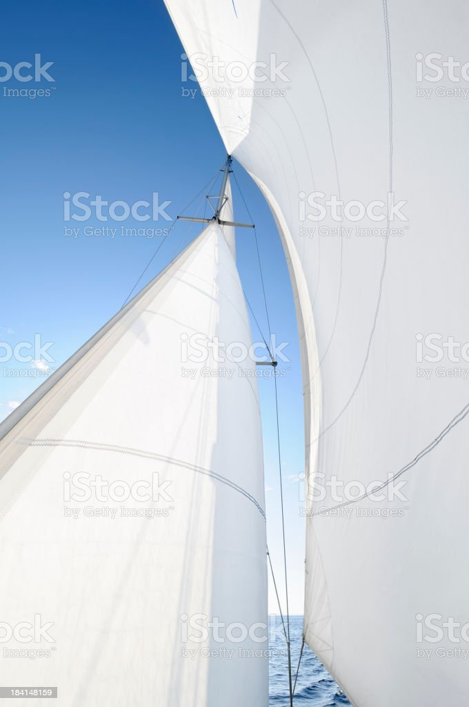 A white sail being blown by the wind stock photo