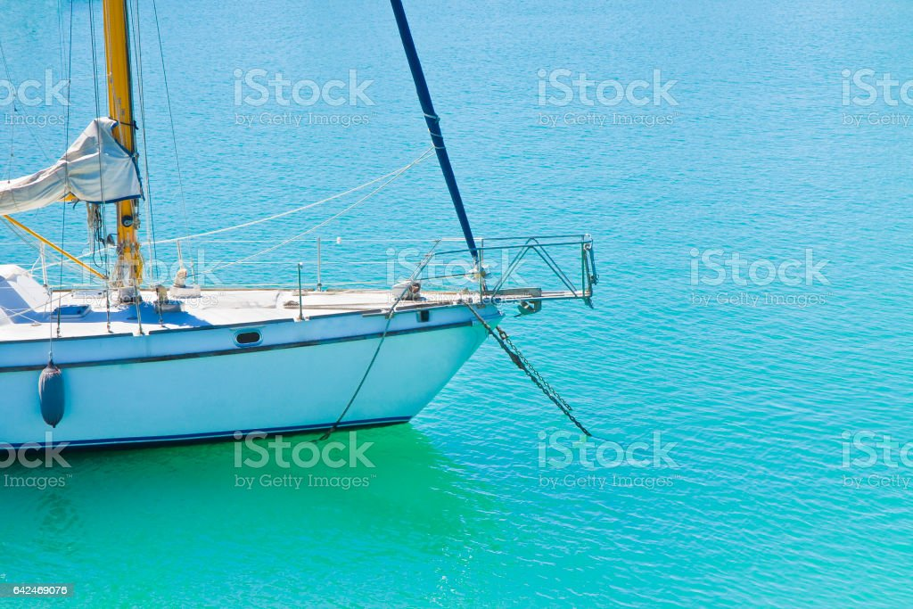 White sail boat moored - image with copy space stock photo