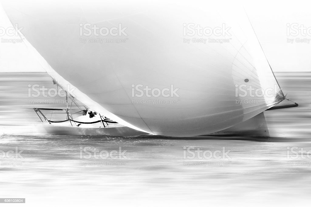 white sail boat with spinnaker stock photo